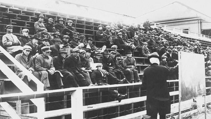 black and white photo of students sitting in bleachers