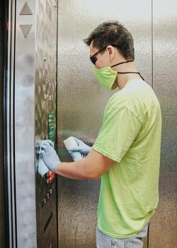 Man spraying an elevator
