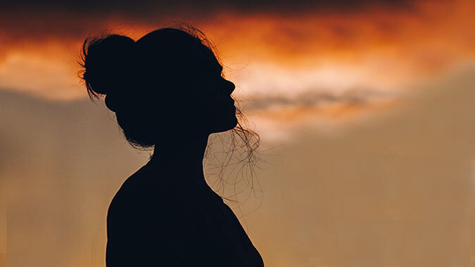 woman with sunset in background