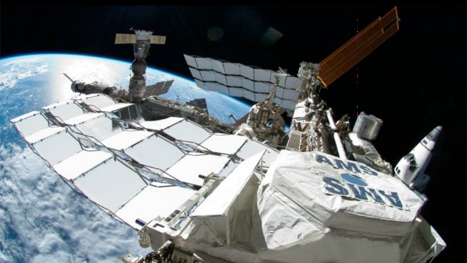 image of spacecraft in space above Earth