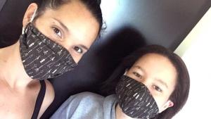 Mikala Maynard with daughter wearing mask