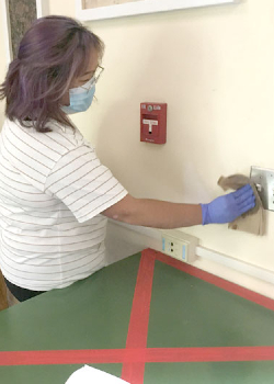 student disinfecting switch
