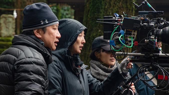 three people looking at a camera
