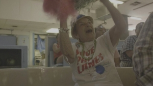 woman cheering with pom poms