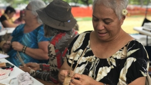 Group of elderly women weaving leaves