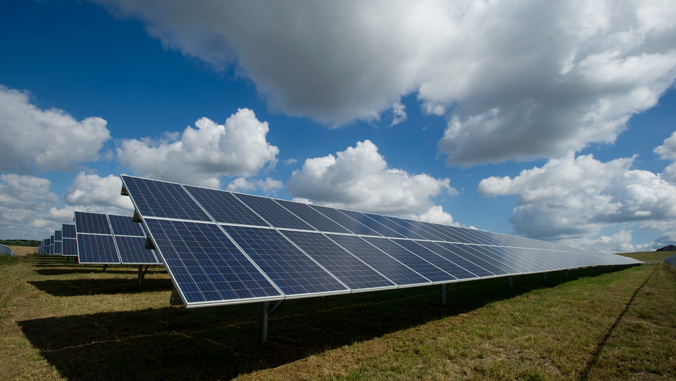 solar panels under clouds and sun