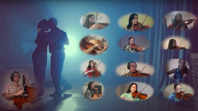 13 string performers on a screen next to two people dancing tango