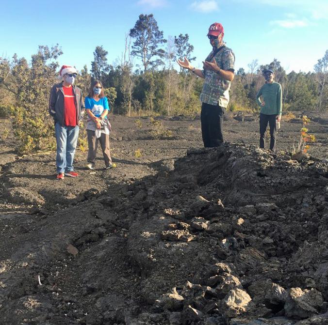 person explaining tree formation at Kilauea