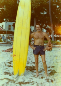 man standing in the sand at Waikiki Beach