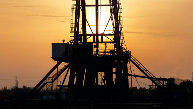 petroleum crane in the setting sun