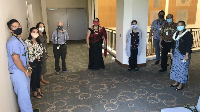 jabsom staff standing apart with masks on