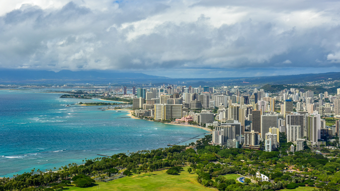 image of buildings and ocean near Honolulu