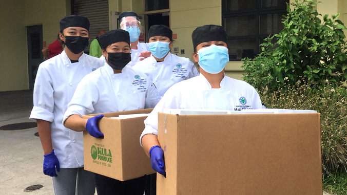 culinary students carrying boxes