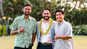 three people smiling at camera