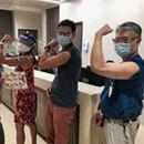 Hopeful JABSOM physicians flex vaccinated arms