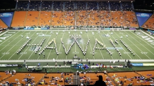 hundreds of marching band students form the word Hawaii