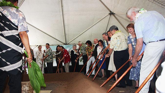 groundbreaking ceremony with oʻo sticks