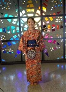 person in a kimono smiling at camera