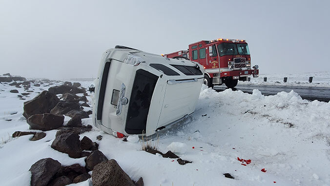 overturned vehicle in the snow