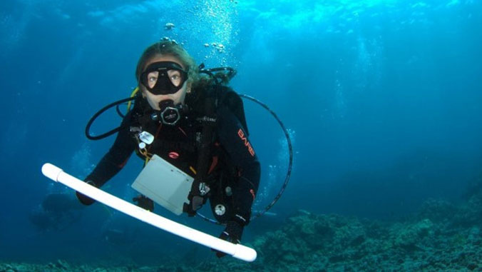 Alexa Runyan in scuba gear underwater