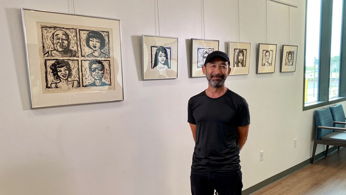 Mike Harada with his art