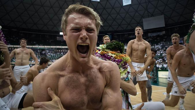 man screaming and celebrating at camera
