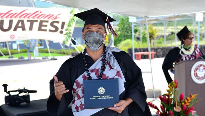 Hawaii C C graduate in regalia