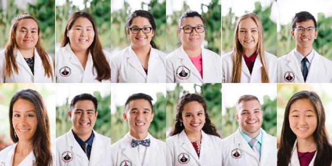 pharmacy students wearing white coats