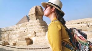 person looking at pyramid