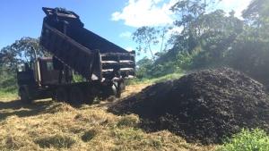 truck dumps coffee pulp