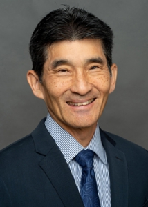 person in a suit smiling