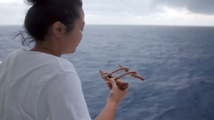 woman holding small canoe