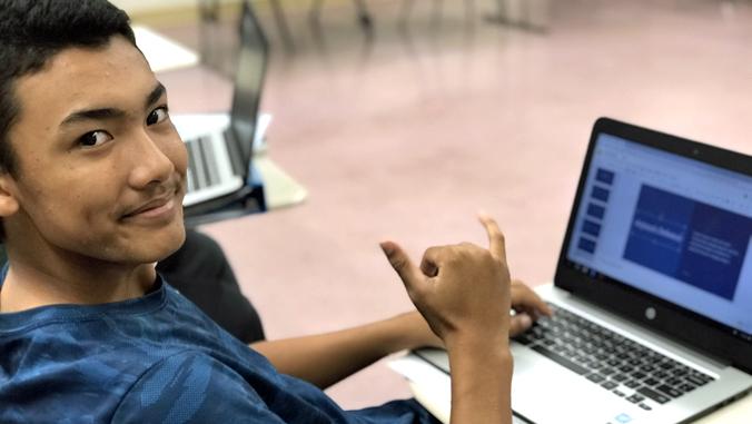 student waving Shaka