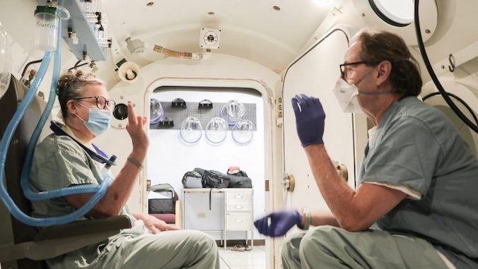 man and woman in the hyperbaric treatment center