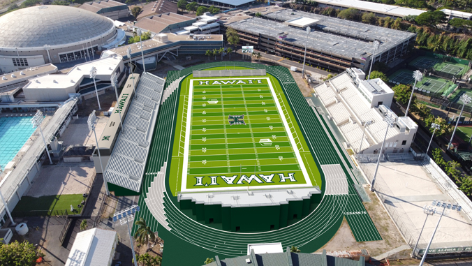 green football field surrounded by grandstands