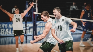 three people celebrate on the volleyball court