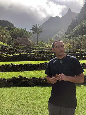 man in front of taro fields