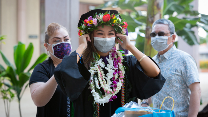 law school graduate getting ready for commencement