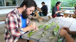 student working on ti leaf