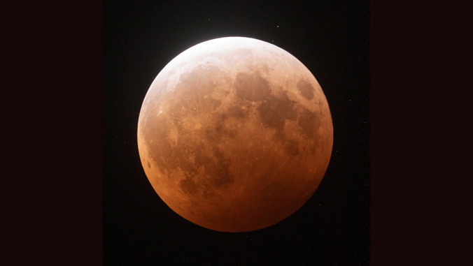 Rust colored moon