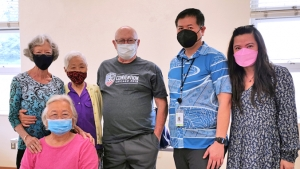 six people wearing masks