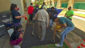 people helping to build concrete ramp