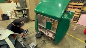 green autonomous vehicle in a lab