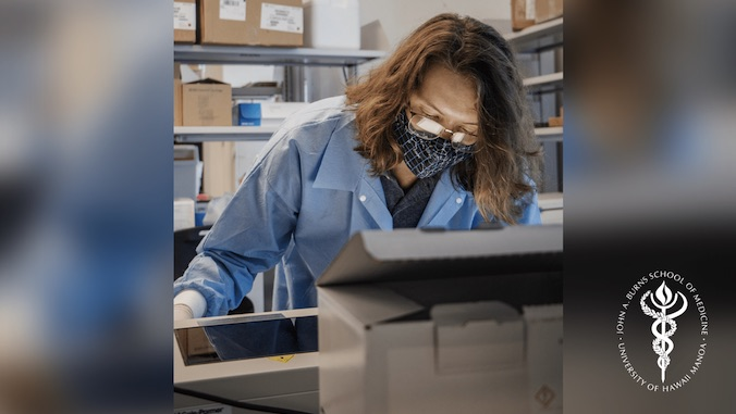 lab technician looking at screen