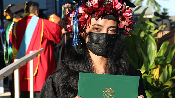 U H Maui College grad with diploma