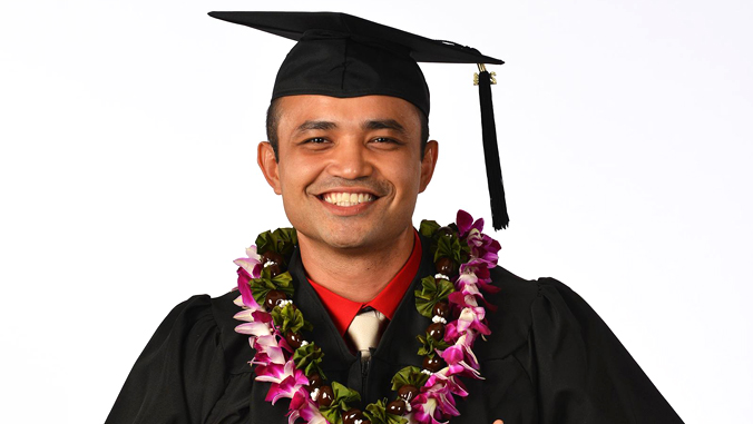 man wearing graduation cap and gown