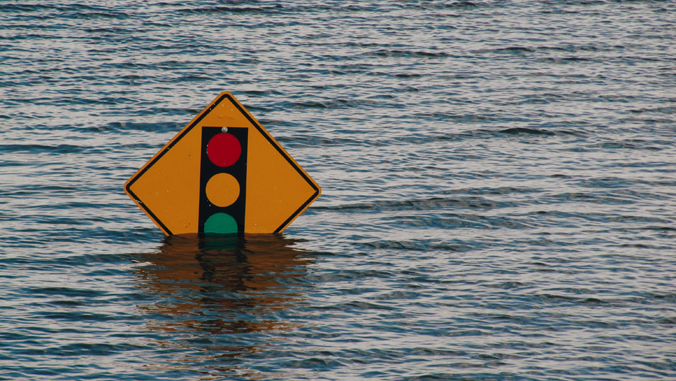 road sign under water