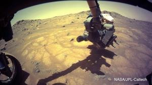 robotic arm examining rocks