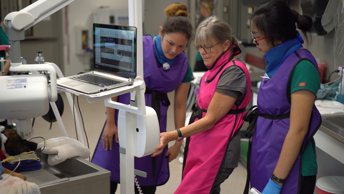 people looking at a screen wearing medical technology gear