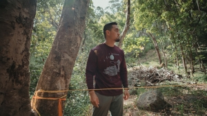 Student near a tree